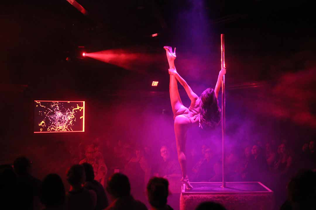 X Burlesque Topless Show Pole Dancer